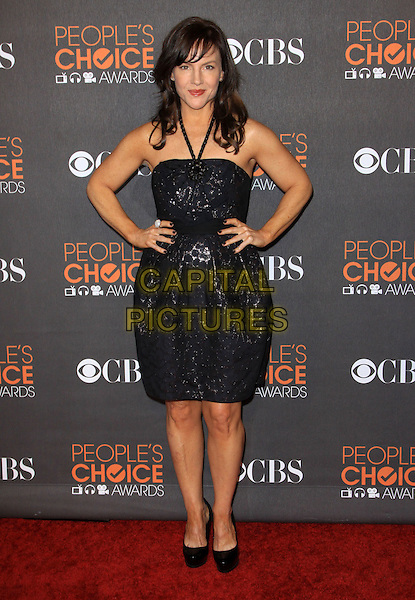 RACHAEL HARRIS.Arrivals at the 2010 People's Choice Awards held at the Nokia Theater L.A. Live in Los Angeles, California, USA. .January 6th, 2010 .full length dress hands on hips black halterneck dress .CAP/ADM/KB.©Kevan Brooks/AdMedia/Capital Pictures.