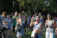 Participants blow soap bubbles during a soap bubble day in a public park in Budapest, Hungary on August 19, 2012. ATTILA VOLGYI