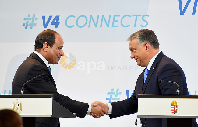 Egyptian President Abdel Fattah al-Sisi shakes hands with Hungarian Prime Minister Viktor Orban ahead of a joint press conference in Budapest on July 4, 2017 during a summit of the Visegrad group countries (V4) and Egypt. Photo by Egyptian President Office