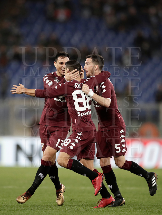 Calcio, Serie A: Roma, stadio Olimpico, 11 dicembre 2017.<br /> Torino's Tomas Rincon (c) celebrates after scoring with his teammates Nicolas Burdisso (l) and Mirko Valdifiori (r) during the Italian Serie A football match between Lazio and Torino at Rome's Olympic stadium, December 11, 2017.<br /> UPDATE IMAGES PRESS/Isabella Bonotto
