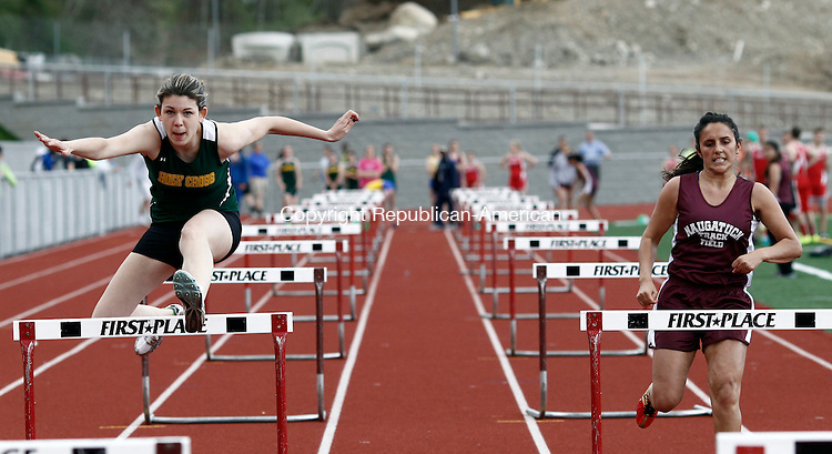 Naugatuck, CT- 06 May 2014-050614CM02-  Holy Cross' Robyn Grimshaw, left, clears a hurdle as she races against Naugatuck's Carla Soares during the girls 100m hurdles during a track meet in Naugatuck on Tuesday.  Grimshaw won the event with a time of 17.69.  Naugatuck hosted Holy Cross, Wolcott and Seymour.  Christopher Massa Republican-American