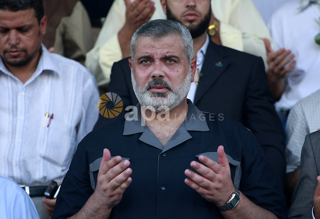 Palestinian Prime minister Ismail Haniya participate at a soccer exhibition marking the opening of the Yarmouk Stadium in Gaza City, Friday Aug. 7, 2009. The new soccer stadium has been sponsored by Hamas. Photo By Mohammed Asad