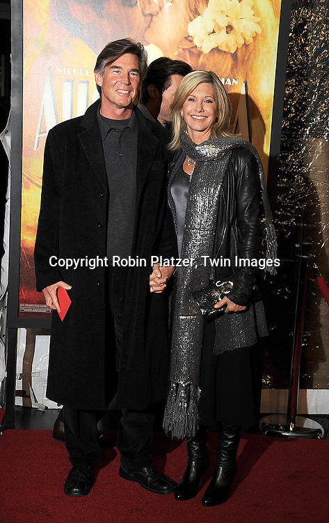 "Olivia Newton-John and new husband John Esterling..posing for photographers at The New York Movie Premiere of ""Australia"" on November 24, 2008 at The Ziegfeld Theatre. ....Robin Platzer, Twin Images....212-935-0770"