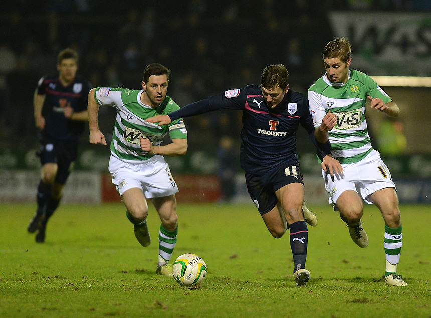 Preston North End's Lee Holmes battles with Yeovil Town's Sam Foley ..Football - npower Football League Division One - Yeovil Town v Preston North End - Tuesday 12 th 2013 - Huish Park - Yeovil..© CameraSport - 43 Linden Ave. Countesthorpe. Leicester. England. LE8 5PG - Tel: +44 (0) 116 277 4147 - admin@camerasport.com - www.camerasport.com