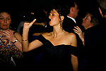 'WARWICKSHIRE HUNT BALL', ON THE DANCE FLOOR WHILE COUPLES SMOOCH, A YOUNG WOMAN WEARING A PEARL NECKLACE LETS HER BLACK EVENING DRESS SLIP FROM HER SHOULDER AS SHE TAKES A DRINK FROM A BOTTLE OF WINE