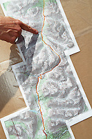 A race director uses a topographic map of Resurrection Pass to explain one of the more confusing areas of the Resurrection Pass Trail 100-Miler ultramarathon race. The race also has a 50-mile event. Both take place in the Kenai Mountains and Chugach National Forest between Cooper Landing and Hope, Alaska.