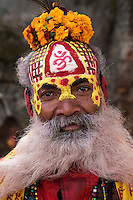 Saddhu Portrait - In Hinduism, sadhu is a common term for an ascetic or yogi who has given up pursuit of the first three Hindu goals of life: kama (enjoyment), artha (practical objectives), and dharma (duty). The sadhu is dedicated to achieving the fourth and final Hindu goal of life - liberation through meditation. Sadhus usually wear ochre colored clothing, symbolizing renunciation