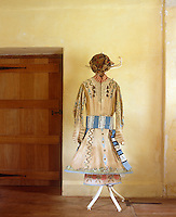 A hand-painted robe, with a blue and white striped sash, its hem lined with stiff tubing to make it stand out