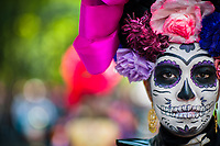 A young woman, dressed as La Catrina, a Mexican pop culture icon representing the Death, takes part in the Day of the Dead celebrations in Mexico City, Mexico, 29 October 2016. Day of the Dead (Día de Muertos), a syncretic religious holiday combining the death veneration rituals of the ancient Aztec culture with the Catholic practice, is celebrated throughout all Mexico. Based on the belief that the souls of the departed may come back to this world on that day, people gather at the gravesites in cemeteries praying, drinking and playing music, to joyfully remember friends or family members who have died and to support their souls on the spiritual journey.