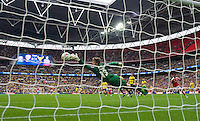 Goalkeeper Benjamin Buchel of Oxford United is beaten by Adam Hammill of Barnsley (out of shot ) to make it 3-2 during the Johnstone's Paint Trophy Final match between Oxford United and Barnsley at Wembley Stadium, London, England on 3 April 2016. Photo by Alan  Stanford / PRiME Media Images.