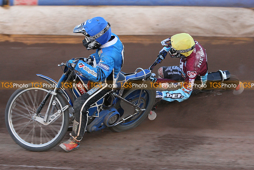Heat 11: David Stachyra (blue) rides past as Kauko Nieminen (yellow) crashes out - Ipswich Witches vs Lakeside Hammers - Sky Sports Elite League Speedway at Foxhall Stadium, Ipswich, Suffolk - 25/06/09- MANDATORY CREDIT: Gavin Ellis/TGSPHOTO - Self billing applies where appropriate - 0845 094 6026 - contact@tgsphoto.co.uk - NO UNPAID USE.