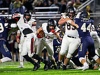 Pea Ridge vs Shiloh Christian - Pea Ridge Junior Samuel Beard (2) squeezes through the hole opened up by Pea Ridge's Thaddeus Timmons (63 )<br />