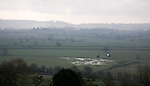 View towards Compton Dundon over wet lowland fields of the Somerset Levels, from Glastonbury, Somerset, England