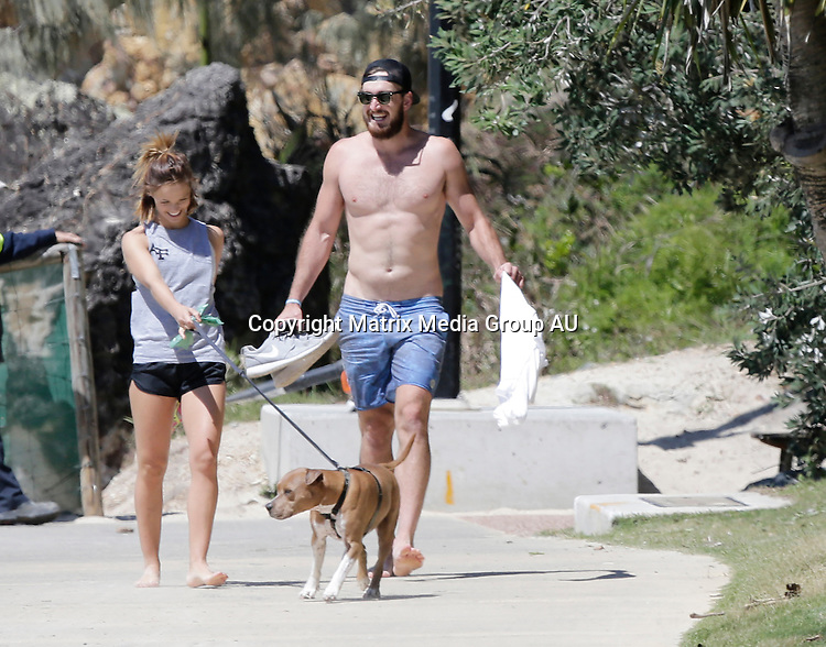 24 SEPTEMBER 2015 SYDNEY AUSTRALIA<br /> <br /> EXCLUSIVE PICTURES<br /> <br /> Lauren Brant pictured walking her dog along a Gold Coast Beach with her new boyfriend and Gold Coast Suns AFL player Charlie Dixon.