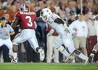 Jan 7, 2010; Pasadena, CA, USA; Texas Longhorns defensive end Sergio Kindle (2) tackles Alabama Crimson Tide running back Trent Richardson (3) during the third quarter of the 2010 BCS national championship game at the Rose Bowl.  Mandatory Credit: Mark J. Rebilas-
