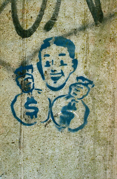 Stencil graffiti of a man holding sacks of money.