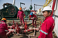 A Chinese man working on an oil rig in South Sudan. China has invested heavily in Sudan's oil industry.