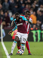 Arthur Masuaku of West Ham United holds off Kurt Zouma (on loan from Chelsea) of Stoke City during the Premier League match between West Ham United and Stoke City at the Olympic Park, London, England on 16 April 2018. Photo by Andy Rowland.