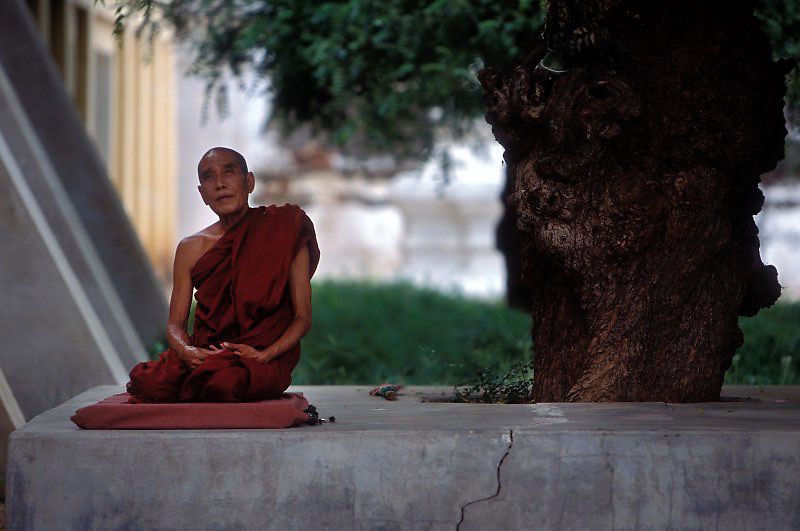 A Buddhist monk meditates in the surrounds of the Shwezigon Pagoda, Bagan, Burma, July 2006. Photo: Ed Giles.