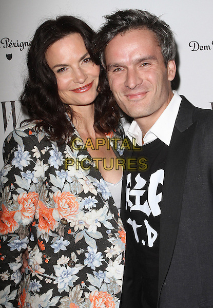 Rosetta Millington Getty and Balthazar Getty.W Magazine's 69th Annual Golden Globe Awards Celebration held at The Chateau Marmont, West Hollywood, California, USA, 13th January 2012..half length husband wife couple  black white floral print jacket blazer  grey gray suit shirt jumper .CAP/ADM/KB.©Kevan Brooks/AdMedia/Capital Pictures.