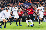 Paul Pogba of Manchester United (R) attempts a kick while being defended by Jeison Murillo of Valencia CF (L) during the UEFA Champions League 2018-19 match between Valencia CF and Manchester United at Estadio de Mestalla on December 12 2018 in Valencia, Spain. Photo by Maria Jose Segovia Carmona / Power Sport Images