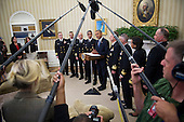 United States President Barack Obama is framed by microphones as he meets with members of the Public Health Service Commissioned Corps (PHS CC) after signing a citation awarding the Presidential Unit Citation to PHS CC members who participated in the Ebola containment efforts in West Africa, in the Oval Office at The White House in Washington, D.C., U.S., on Thursday, Sept. 24, 2015.<br /> Credit: Rod Lamkey Jr. / Pool via CNP