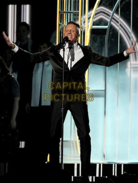LOS ANGELES, CA - JANUARY 26 : Macklemore performs onstage at The 56th Annual GRAMMY Awards at Staples Center on January 26, 2014 in Los Angeles, California.<br /> CAP/MPI/PG<br /> &copy;PGFMicelotta/MediaPunch/Capital Pictures