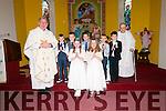 Scoil Cheann Tra pupils Cian Ó Cinnéide, Cathal Ó Dufaigh, Joshua Ó Loingsigh, Leo de Brún, Eoghan Ó Fiannachta, Nichola de Nais and Úna Ní Mhurchú, here pictured with an Canónach Ó Tomas Ó Luanaigh and Monsignor Ó Fiannachta, the day of their First Communion at Séipeal Caitlín Naofa, Ceann Tra, on Sunday morning.
