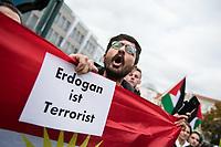 """Mehrere tausend Menschen demonstrierten am Sonntag den 12. Oktober 2019 in Berlin gegen die Invasion des tuerkischen Militaer in die nordsyrische Region Rojava, die unter kurdischer Verwaltung steht. Nach Meinung des tuerkischen Praesidenten Erdogan sind die dortigen Kurden Unterstuetzer der, in der Tuerkei verbotenen, Kurdischen Arbeiterpartei PKK. Erdogan will mit seiner Invasion die in Rojava lebenden Kurden vertreiben, um dort syrische Buergerkriegsfluechtlinge als """"Sicherheitszone"""" anzusiedeln.<br /> 12.10.2019, Berlin<br /> Copyright: Christian-Ditsch.de<br /> [Inhaltsveraendernde Manipulation des Fotos nur nach ausdruecklicher Genehmigung des Fotografen. Vereinbarungen ueber Abtretung von Persoenlichkeitsrechten/Model Release der abgebildeten Person/Personen liegen nicht vor. NO MODEL RELEASE! Nur fuer Redaktionelle Zwecke. Don't publish without copyright Christian-Ditsch.de, Veroeffentlichung nur mit Fotografennennung, sowie gegen Honorar, MwSt. und Beleg. Konto: I N G - D i B a, IBAN DE58500105175400192269, BIC INGDDEFFXXX, Kontakt: post@christian-ditsch.de<br /> Bei der Bearbeitung der Dateiinformationen darf die Urheberkennzeichnung in den EXIF- und  IPTC-Daten nicht entfernt werden, diese sind in digitalen Medien nach §95c UrhG rechtlich geschuetzt. Der Urhebervermerk wird gemaess §13 UrhG verlangt.]"""
