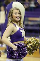 DEC 22, 2015:  Washington cheerleader Nikki Buchanan entertained fans during a TV timeout in the game against Seattle University. Washington defeated Seattle University 79-68 at Alaska Airlines Arena in Seattle, WA.