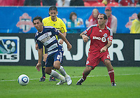 24 July 2010: FC Dallas midfielder Bruno Guarda #8 and Toronto FC midfielder Nick LaBrocca #21 in action during a game between FC Dallas and Toronto FC at BMO Field in Toronto..The final score was a 1-1 draw...