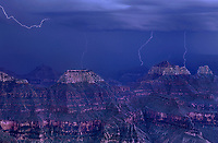 749220229 a summer monsoon lightning storm drifts over the canyon delivering multiple lightning strikes in this view from north rim lodge in grand canyon national park arizona