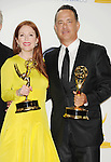 LOS ANGELES, CA - SEPTEMBER 23: Julianne Moore and Tom Hanks pose in the press room at the 64th Primetime Emmy Awards held at Nokia Theatre L.A. Live on September 23, 2012 in Los Angeles, California.