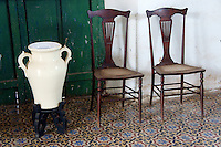 Antique chairs and porcelain vase in main building at Hacienda Yaxcopoil, Yucatan, Mexico.