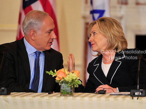 """United States Secretary of State Hillary Rodham Clinton shares some thoughts with Prime Minister Benjamin Netanyahu of Israel as she hosts the """"Relaunch of Direct Negotiations Between the Israelis and Palestinians"""" in the Benjamin Franklin Room of the U.S. Department of State on Thursday, September 2, 2010.  .Credit: Ron Sachs / CNP.(RESTRICTION: NO New York or New Jersey Newspapers or newspapers within a 75 mile radius of New York City)"""