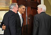 Washington, D.C. - December 15, 2009 -- United States President Barack Obama escorts Senators out of the Roosevelt Room after making a statement to the press following a meeting with members of the Senate Democratic Caucus on health care reform in the Eisenhower Executive Office Building (EEOB) on Tuesday, December 15, 2009. From left to right: U.S. Senator Tom Harkin (Democrat of Iowa), President Obama, U.S. Senator Christopher Dodd (Democrat of Connecticut)..Credit: Ron Sachs - Pool via CNP