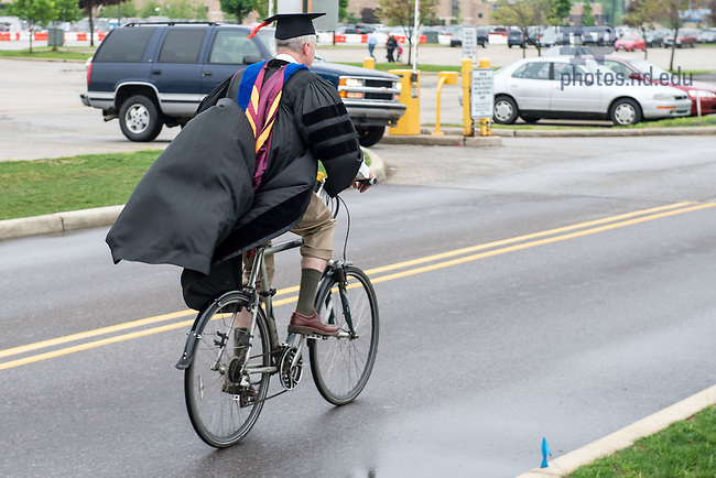 May 16, 2015; A faculty member bikes to the Graduate School Commencement ceremony, 2015. (Photo by Matt Cashore/University of Notre Dame)