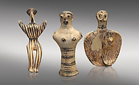 Mycenaean female figurines  from Mycenae tombs, Archaeological Museum Athens.  Grey Background<br /> <br /> Left: Seated Mycenaean female figurine with raies arms, from Mycenae tomb 91,  Cat No 3193. <br /> <br /> Middle: Hollow Mycenaean female figurine, adorant, wearing a necklace, from Mycenae tomb 40,  Cat No 2494. <br /> <br /> Right: Upper part of a Mycenaean female figurine with stylised arms wearing a necklace, from Mycenae tomb 101,  Cat No 4690