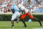 06 October 2007: North Carolina's Anthony Elzy (6) is tackled by Miami's Kenny Phillips (1). The University of North Carolina Tar Heels defeated the University of Miami Hurricanes 33-27 at Kenan Stadium in Chapel Hill, North Carolina in an Atlantic Coast Conference NCAA College Football Division I game.