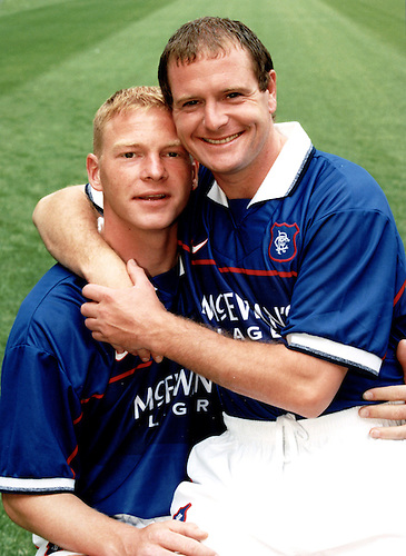1997 RANGERS TEAM PHOTO-SHOOT AT IBROX STADIUM, PAUL GASCOIGNE CUDDLES UP TO JORG ALBERTZ, ROB CASEY PHOTOGRAPHY.