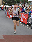 Paul McQuillan finishes in 3rd place in the Clogherhead 10k run. Photo: Colin Bell/pressphotos.ie
