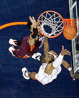 Virginia forward Akil Mitchell (25) shoots in front of Virginia Tech forward Maurice Kirby (21) during the game Saturday in Charlottesville, VA. Virginia won 65-45.