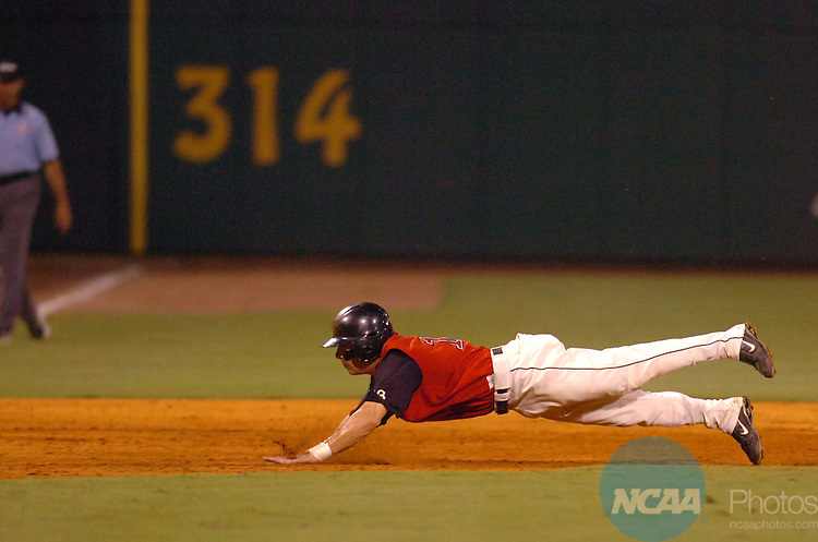 03 June 2006:  Outfielder Troy Ferguson (13) of The University of Tampa dives safely into third base against CSU Chico -  Chico State during the Division II Men's Baseball Championship held at Riverwalk Stadium, Montgomery, Alabama. The Chico State baseball team was one pitch away from winning the national championship, but The University of Tampa put together three two-out base hits in the ninth inning to tie the game. Tampa went on to beat Chico State 3-2 in the tenth inning. Larry French/NCAA Photos