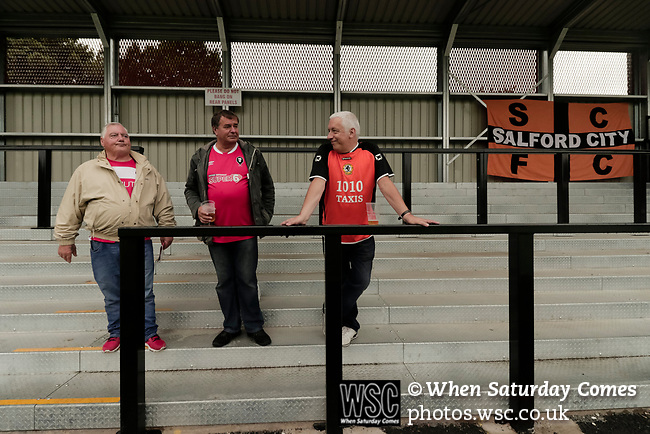 Salford City 2 FC United of Manchester 1, 15/07/2017. Moor Lane, Pre Season Friendly. Salford fans, one wearing the clubs traditional orange shirt. Salford City v FC United of Manchester in a pre season friendly at Moor Lane Salford. Photo by Paul Thompson.