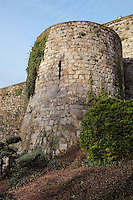 Defensive tower, 13th century, in the ramparts of the medieval castle of Chateau-Thierry, Picardy, France. The first fortifications on this spur over the river Marne date from the 4th century and the first castle was built in the 9th century Merovingian period by the counts of Vermandois. Thibaud II enlarged the castle in the 12th century and built the Tour Thibaud, and Thibaud IV expanded it significantly in the 13th century to include 17 defensive towers in the walls and an East and South gate. The castle was largely destroyed in the French Revolution after having been a royal palace since 1285. In 1814 it was used as a citadel for Napoleonic troops. Picture by Manuel Cohen