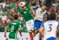 Mexico City, Mexico - Sunday June 11, 2017: Michael Bradley, Héctor Herrera during a 2018 FIFA World Cup Qualifying Final Round match with both men's national teams of the United States (USA) and Mexico (MEX) playing to a 1-1 draw at Azteca Stadium.