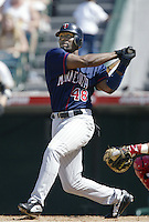 Torii Hunter of the Minnesota Twins bats during a 2002 MLB season game against the Los Angeles Angels at Angel Stadium, in Anaheim, California. (Larry Goren/Four Seam Images)