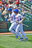 Tennessee Smokies third baseman Jason Vosler (22) leaves the field with the bat boy after hitting a home run during a game against the Jackson Generals at Smokies Stadium on April 11, 2018 in Kodak, Tennessee. The Generals defeated the Smokies 6-4. (Tony Farlow/Four Seam Images)