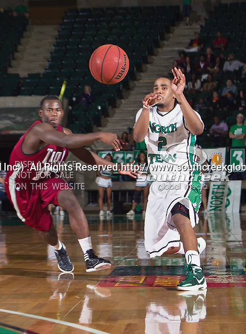 North Texas Mean Green guard Brandan Walton (2) in action during the game between the Troy Trojans and the University of North Texas Mean Green at the North Texas Coliseum,the Super Pit, in Denton, Texas. UNT defeats Troy 87 to 65.....