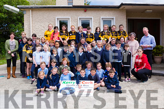 Pupils from Third &amp; Fourth Class, Glenbeigh National School pictured with: <br /> L-R Trish Kelly from Kerry Cork Health Link Bus, teacher Mrs Karen Joy, teacher Mrs Mary O'Riordan, Breda Dyland Manager of Kerry Cork Health Link Bus and School Principal Seamus McMahon.<br /> <br /> Each Year Third &amp; Fourth Class in Glenbeigh National School, co-ordinated by their teacher Mrs Cliodhna Moynihan, complete a fundraiser during Lent and this year it was decided that funding would go in two directions. One was to the Third World charity, Bothar and the children decided that the other half would go to a local charity and they selected The Kerry Cork Health Link Bus as the recipients of &Auml;540 raised in a very busy organised &amp; supervised campaign which culminated in a successful Bring &amp; Buy Sale.